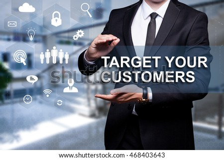 "White text with icons ""Target Your Customer"" in the hands of a businessman. Business concept. Internet concept."