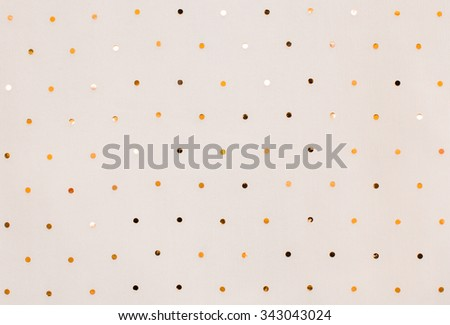 White textile with gold sequins