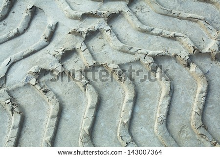 white texture tire tracks close up on the sand - stock photo