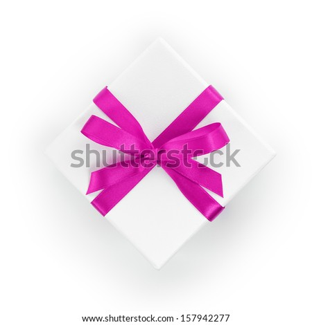 white textured gift box with purple ribbon bow, from above