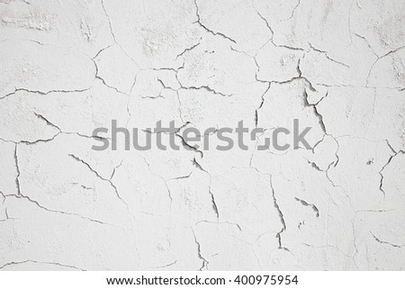 white textured wall with cracks - stock photo
