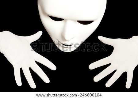 White theatrical mask isolated on black - stock photo
