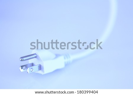 White three prong cord with bluish tone