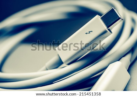 White Thunderbolt Cable Closeup Photo. Thunderbolt Data Transfer Cable.