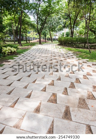 White tile pavement in the urban park. - stock photo