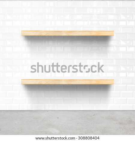 white tile room and concrete flooring with wooden shelf, Mock up for display of product. - stock photo