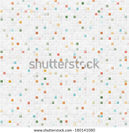 white tile wall background with colorful pieces - stock photo