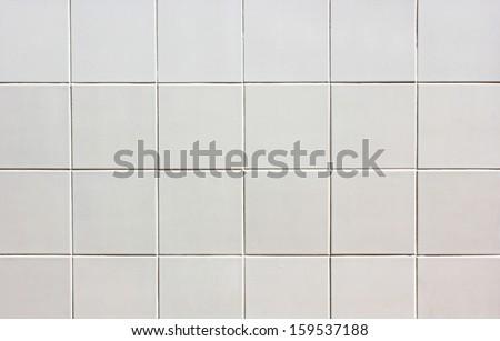 white tile wall. Seamless texture. - stock photo