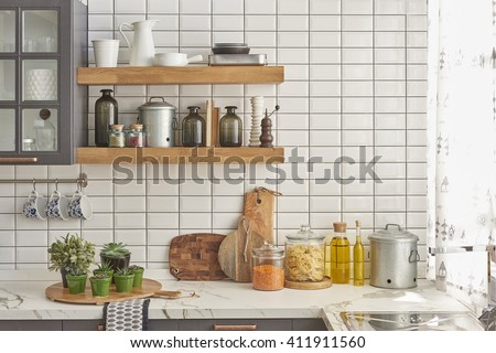 white tiles wall modern kitchen with chopping board
