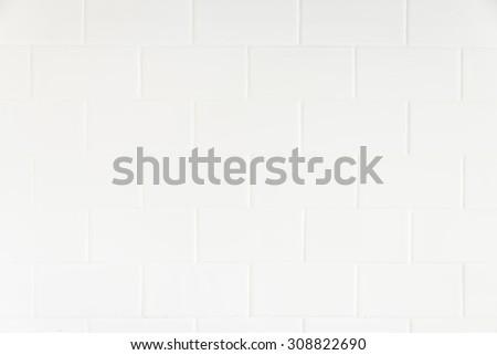 White tiles wall textures background - stock photo