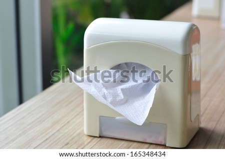 White tissue box on wooden table. - stock photo