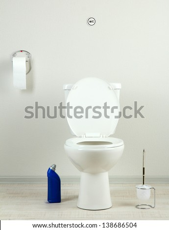 White toilet bowl and  cleaner bottle in a bathroom - stock photo