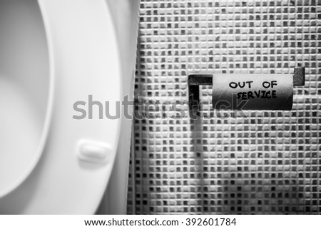 White toilet bowl and Empty Toilet Paper. Out of service. - stock photo