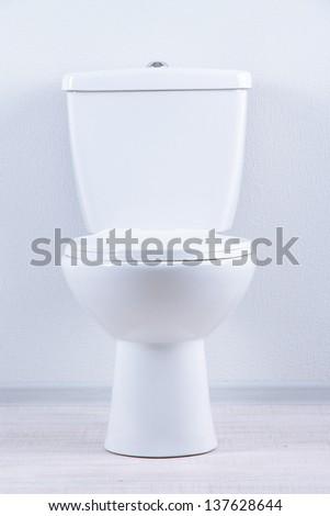 White toilet bowl in a bathroom - stock photo