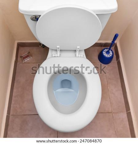 White toilet bowl in a bathroom interior  - stock photo