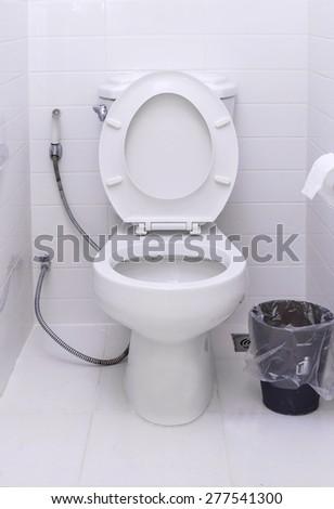 White toilet bowl in a modern bathroom. - stock photo