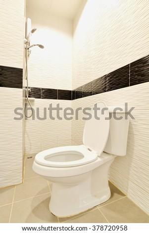 White toilet bowl in the bathroom. - stock photo