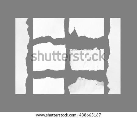 white torn paper isolated on grey background with clipping path.