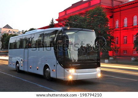 white tourist bus of city lights - stock photo
