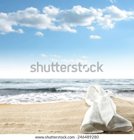 white  towel and sand  - stock photo