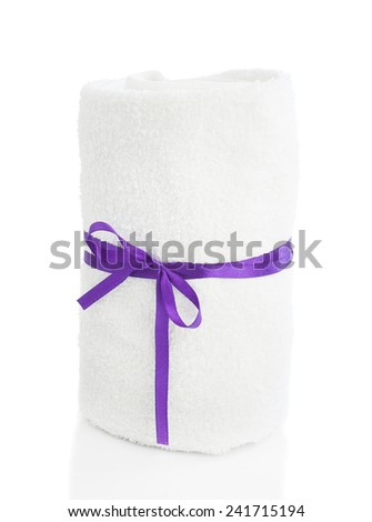 White towel roll with violet ribbon isolated on white background - stock photo