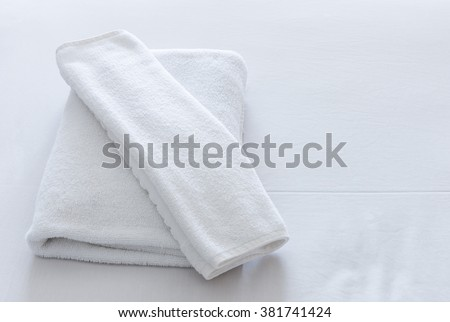 White towel set on the bed of hotel. - stock photo