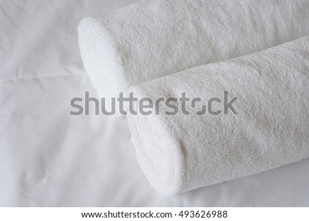 white towels on bed sheet