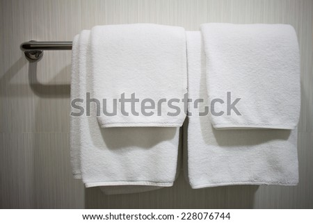 white towels prepared on hanger.  - stock photo