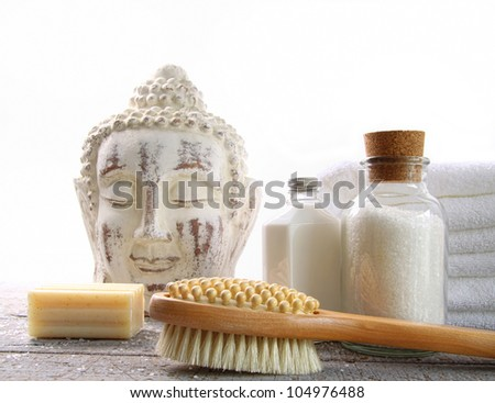 White towels with spa accessories against white background - stock photo