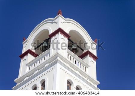 White traditional Greek church tower on Santorini island in Greece - stock photo