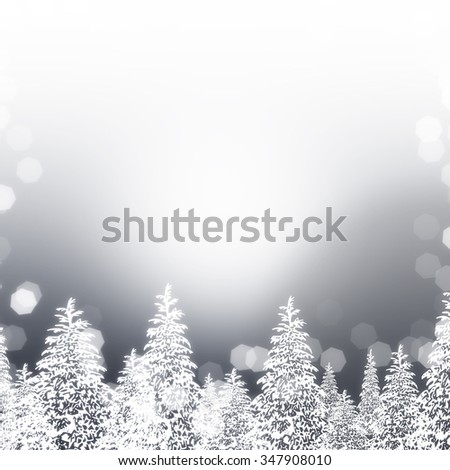 White trees with a winter glow on a silver background with bokeh effect.