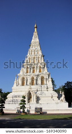 """White Triangle Pagoda at ancient buddhist temple """"Wat Chedi Liam"""" at Wiang Kum Kam, Chiangmai Thailand.  - stock photo"""