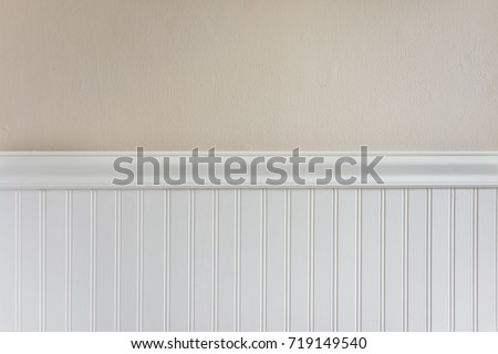 White Trim And Chair Guard With Beige Textured Wall Paint
