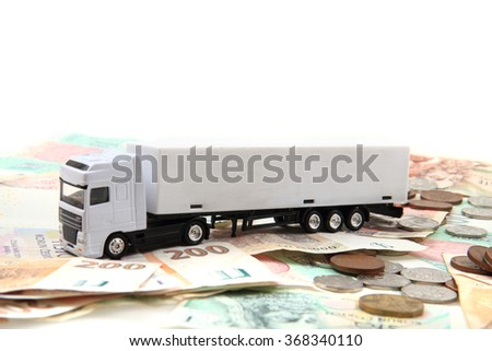 white truck and czech money isolated on the white background - stock photo