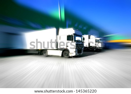 white truck at the warehouse building - stock photo