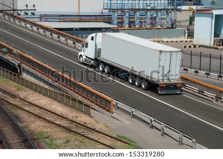 white truck drives near the plant - stock photo