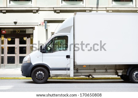 White truck in profile, copy space - stock photo