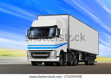 White truck moving on road in sunny summer day - stock photo