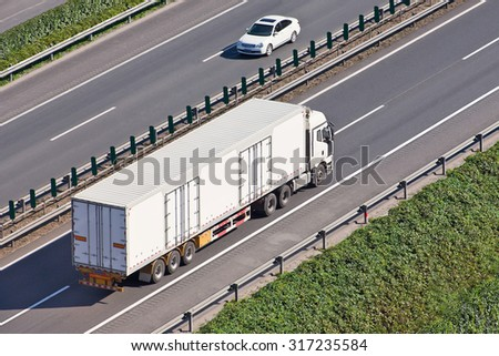 White truck on an expressway.  - stock photo