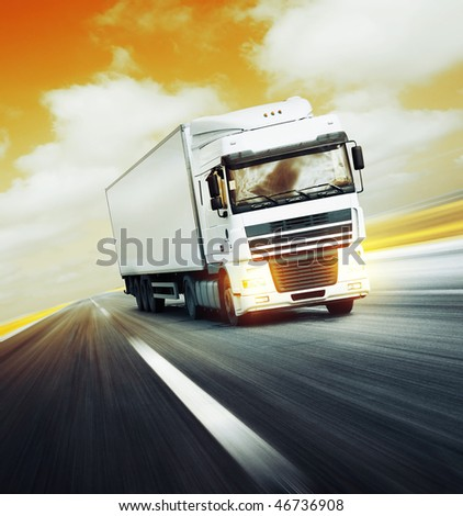 White truck on asphalt road under red abstract sky with clouds - stock photo