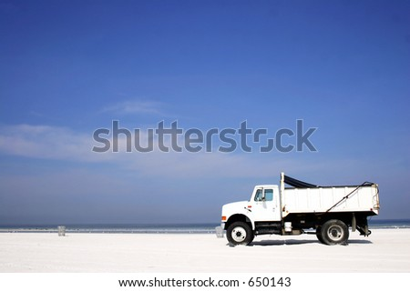 White truck on the beach - stock photo
