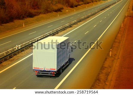 White truck on the highway. Retro style picture. - stock photo