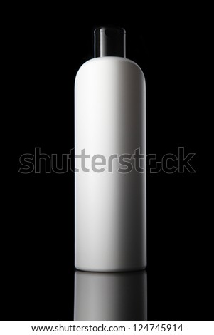 White tube bottle of shampoo, conditioner, hair rinse, gel, mouthwash on a black background with reflection. - stock photo