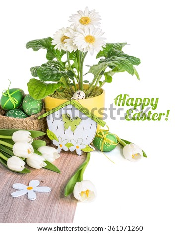 White tulips, gerberas and Easter eggs on wood isolated on white. Space for your text - stock photo