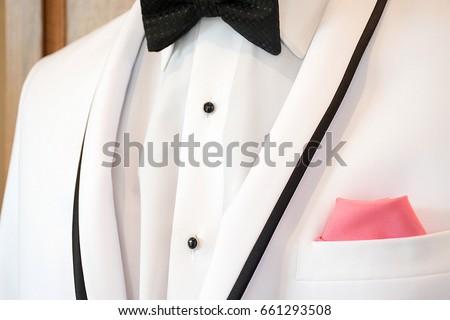 Red Tie Accenting Black Tuxedo Stock Photo 71458456