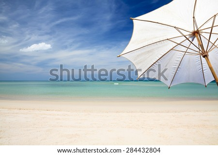 White umbrella beach. - stock photo