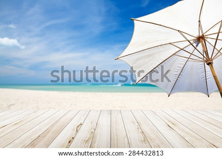 White umbrella beach.
