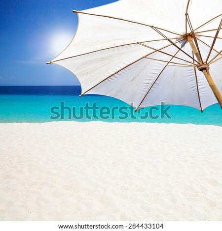 White umbrella beach. - stock photo