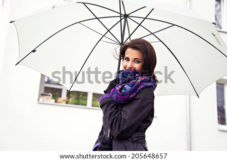 White umbrella in hands of beautiful woman