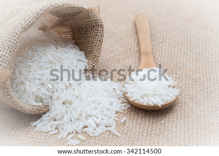 White uncooked rice in small burlap sack